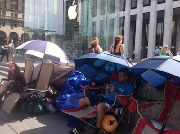 people-lounged-with-umbrellas-outside-the-flagship-fifth-ave-store-in-new-york-city